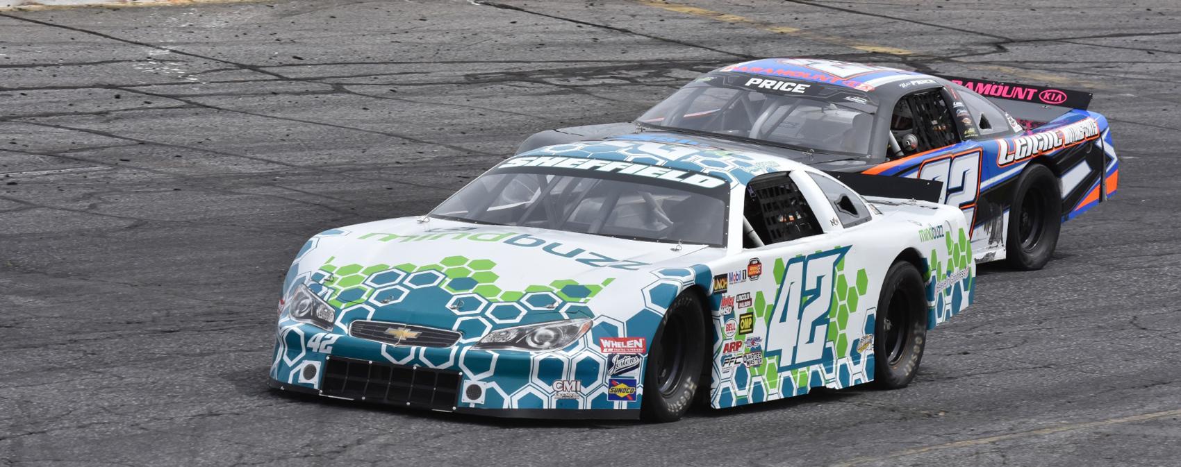 Two race cars on an asphalt track