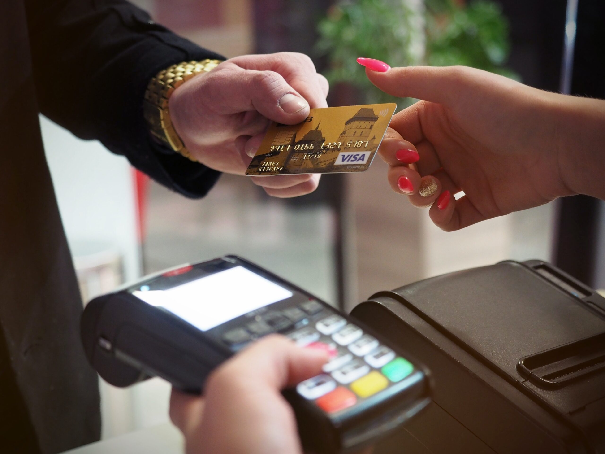 Person handing over credit card